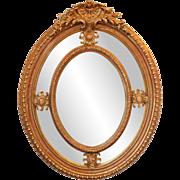 Large oval ornate mirror