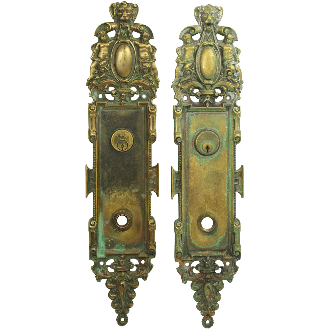 Beautiful pair of figural ornate backplates