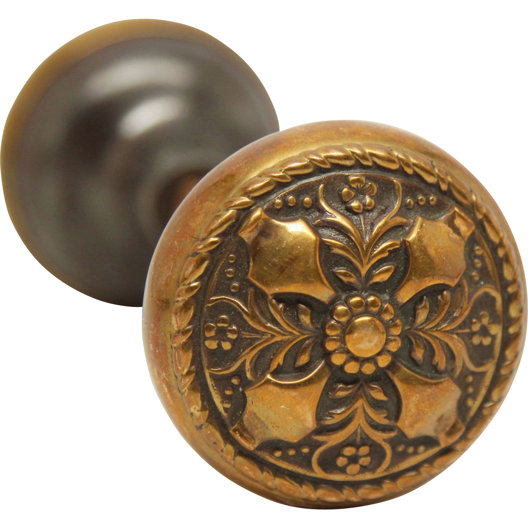Ornate 4 fold floral knob set by Russell and Erwin