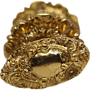 Highly ornate oval brass knob set with matching rosettes