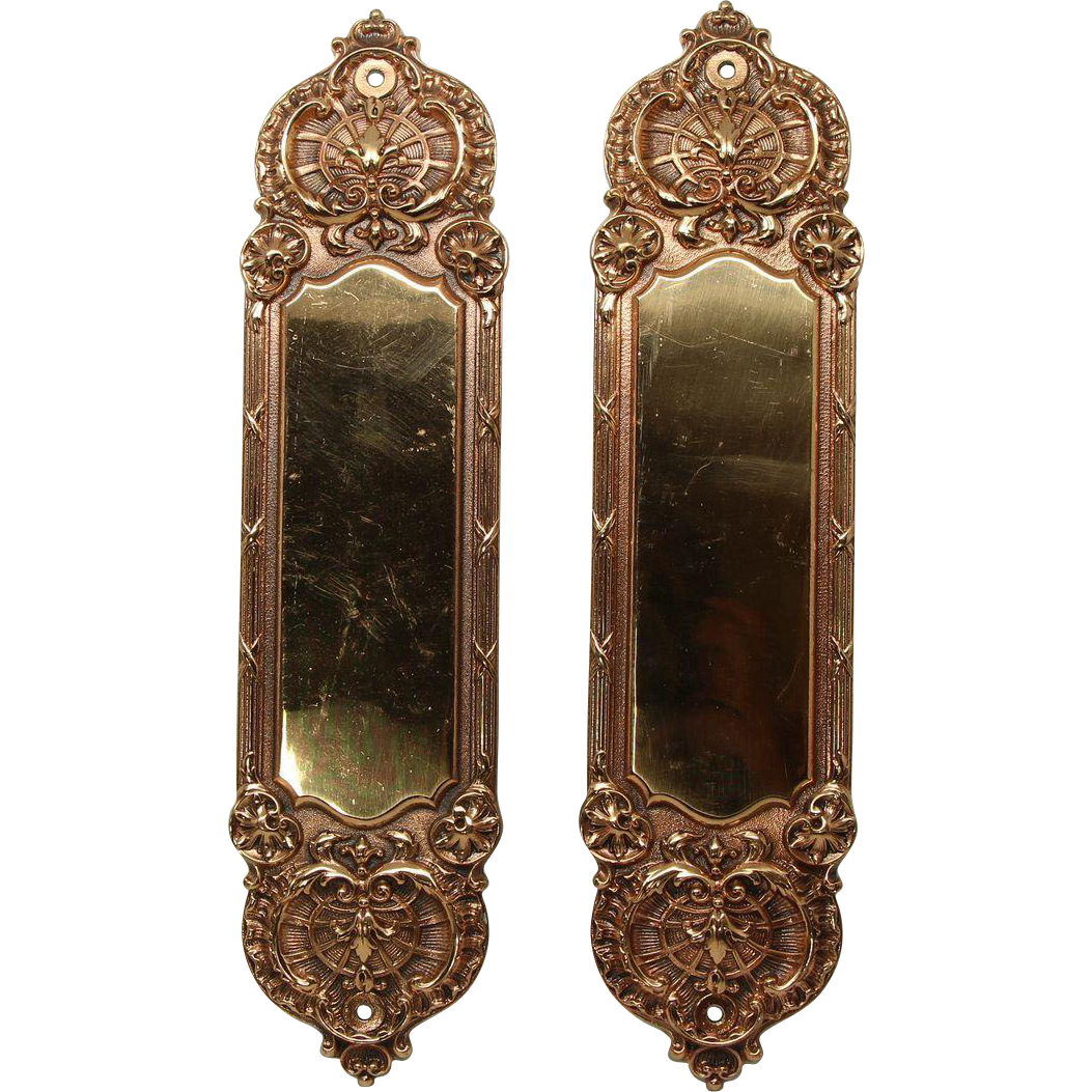 Pair of bronze ornate gilded Yale push plates