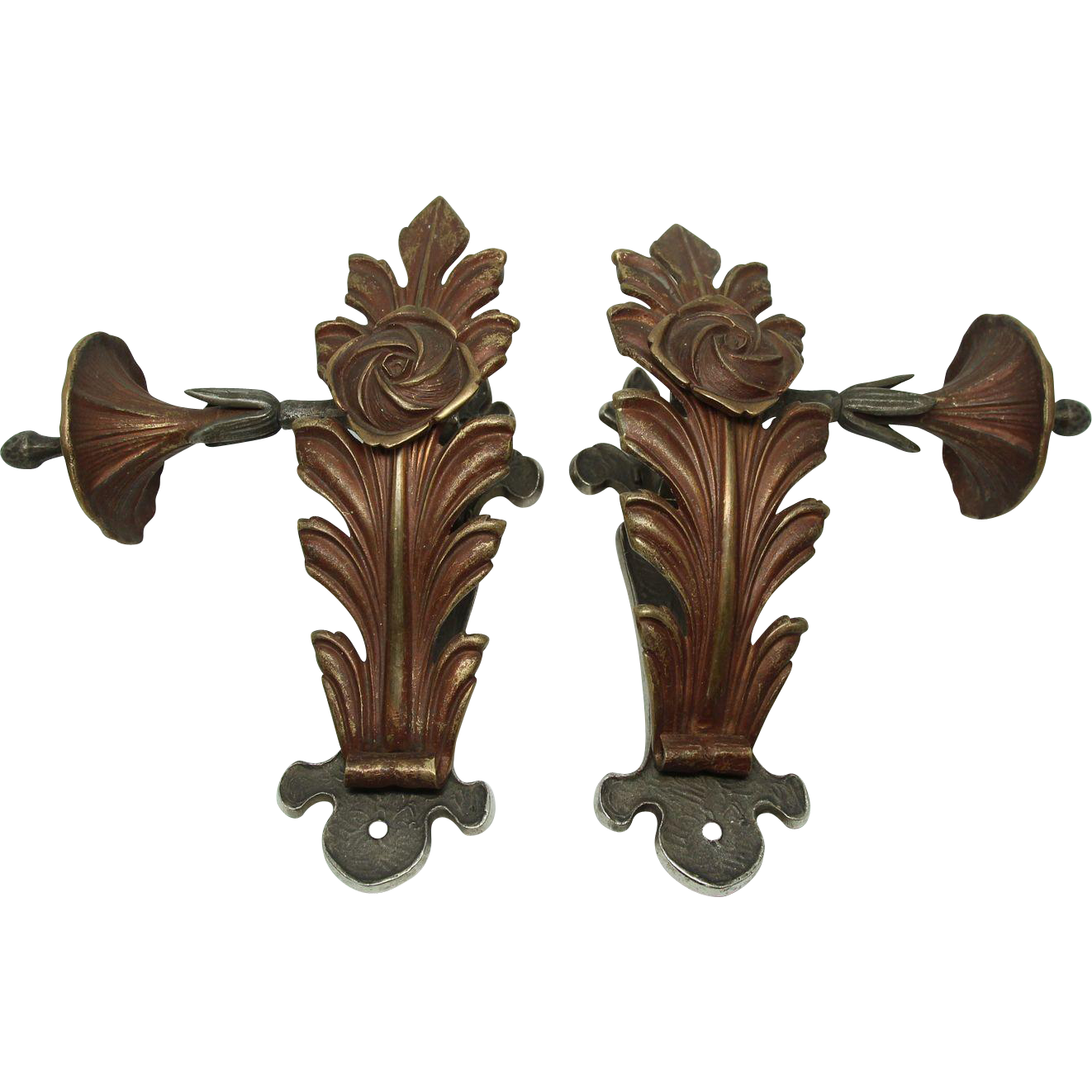 Pair of floral brass curtain tie backs with nickel washed plate