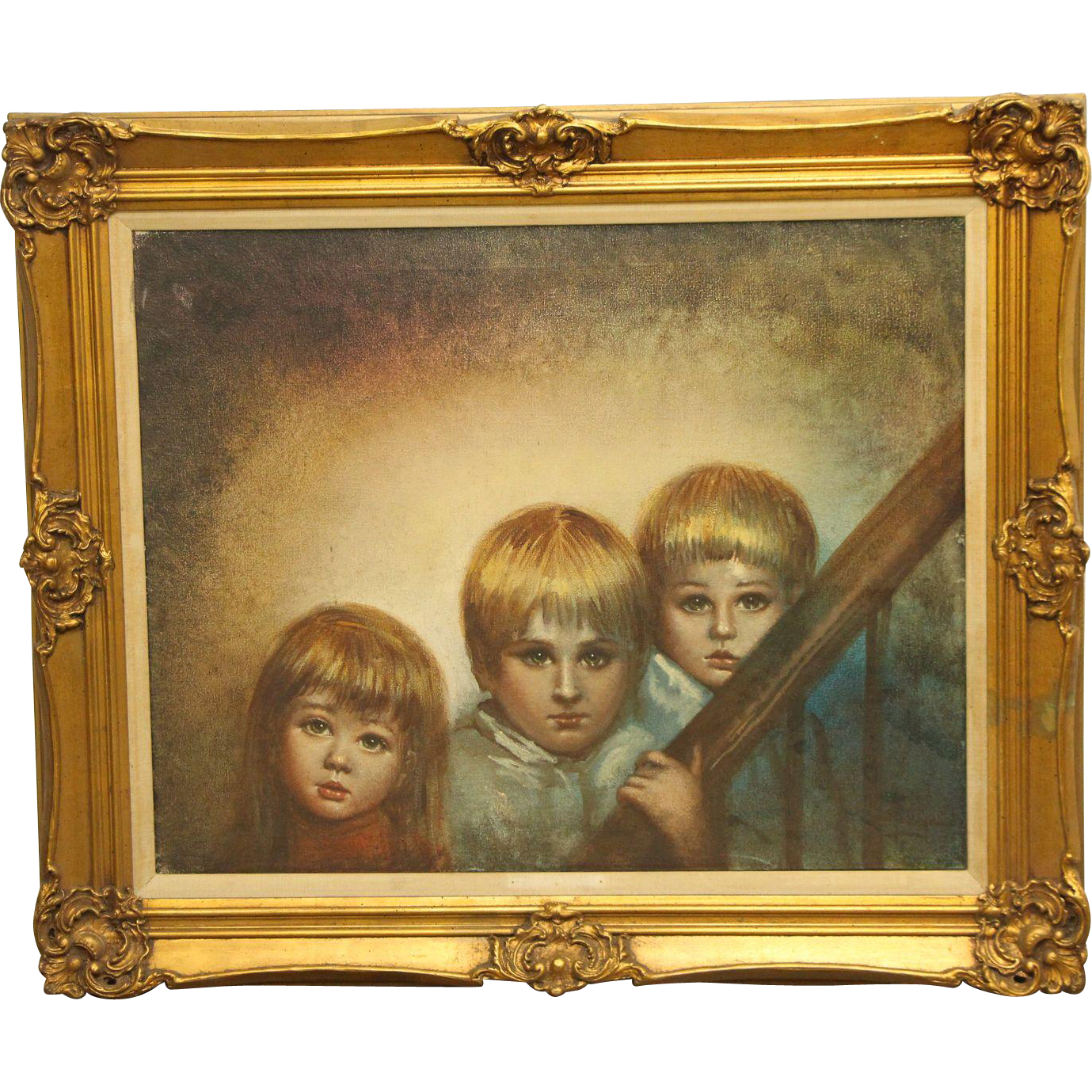 Ornately framed portrait of children