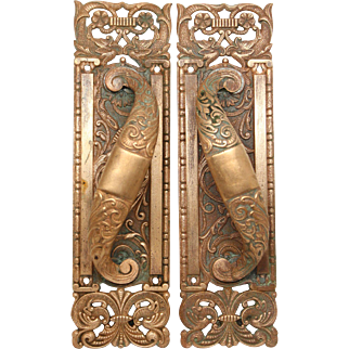 Pair of ornate Columbia decorative door pulls