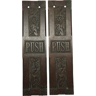 Pair of ornate bronze push plates