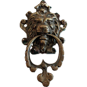 Small brass lion head door knocker