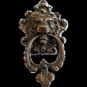 Small brass lion head door knocker