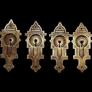 Set of four ornate brass pocket door plates