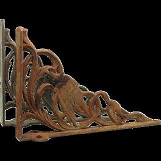 Pair of iron brackets with bird motif