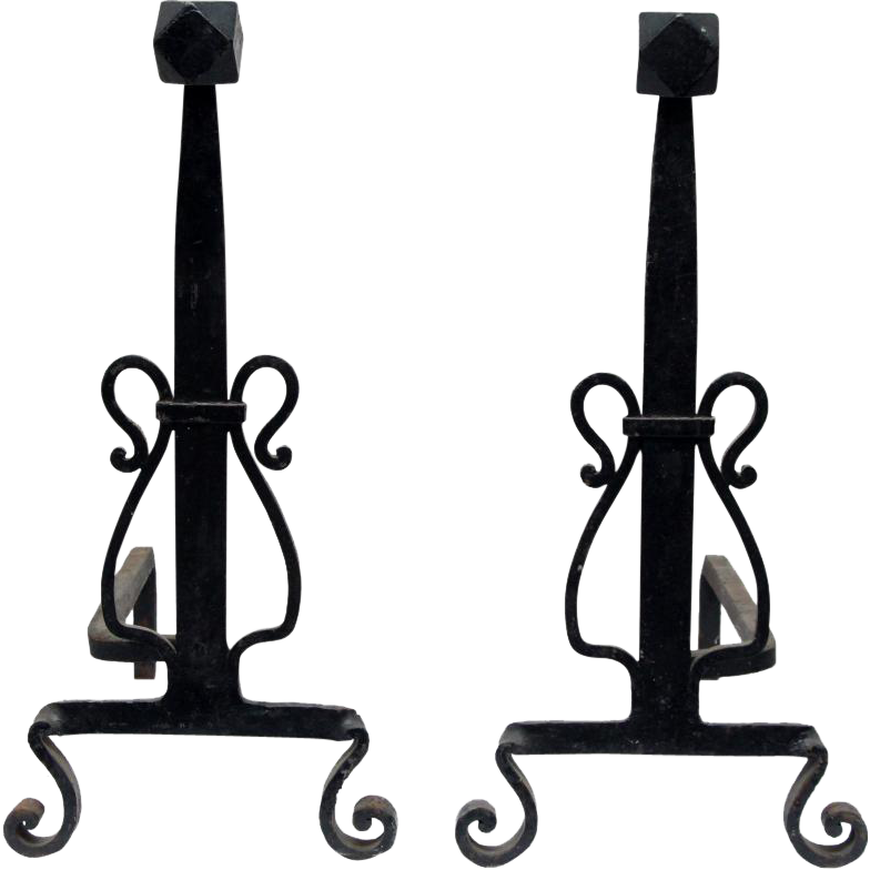 Pair of black andirons with turned feet