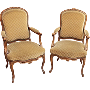 Pair of French carved wood chairs with green upholstery