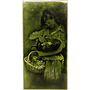 Large green majolica tile with woman figure