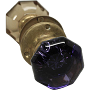 Purple and amber glass knob set with mercury bullet