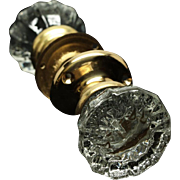 Set of six fluted glass knob sets with plain brass rosettes