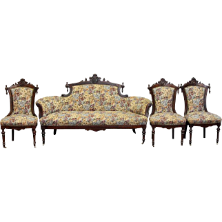 Four piece floral sofa & chair set