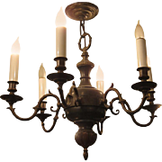 Six arm Colonial style bronze chandelier
