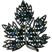 Japaned Black Lacy Leaf Pin Blue Green Rhinestones