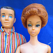 Vintage Barbie and Ken wearing tagged clothes