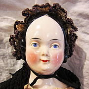 Antique And Unusual Covered Wagon China Doll from 1800's