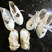 Three Pairs of White Shoes