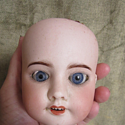 SFBJ 60 Antique Doll Head with Eyes and attachment hook