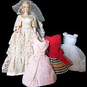 Three Vintage Tagged Mattel Barbie Dresses and a Clone Barbie