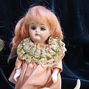 Antique Small All Bisque with Glass Eyes in Peach