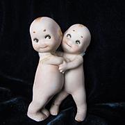 Two Hugger Kewpies