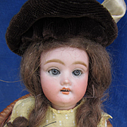 Antique Six Inch German Child in Yellow