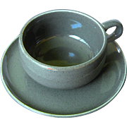 American Modern -cedar green flat cup and saucer by Russel Wright
