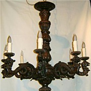 Eight Light Continental Carved Fruitwood Chandelier