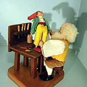 Geppetto at his workbench with Pinocchio