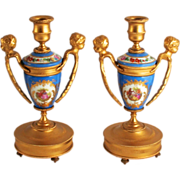 A Pair of French 1870 Sevres Style Angels, Putti or Cherub Candlesticks with Porcelain and Ormolu Fragonard Pictures