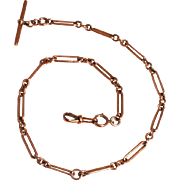 An Antique 19C 9 Karat Rose Gold Watch Chain with T Bar and Clip 14 inches long