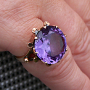 A Ladies 14 Karat Gold Circular Faceted Amethyst Drum Ring Size US 6 UK M