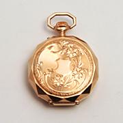 A Working Art Nouveau Antique 14 Karat Gold Swiss Hallmarked Ladies Fob Watch in a Faceted Case