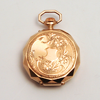 A Working Art Nouveau Antique 14 Karat Gold Swiss Hallmarked Ladies Fob Watch in a Faceted Case