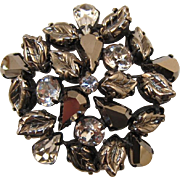 Regency  Hematite Rhinestone and Leafy Domed Brooch