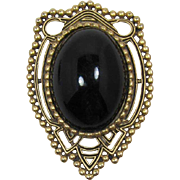 Striking Gold-Tone and Huge Black Cabochon Brooch