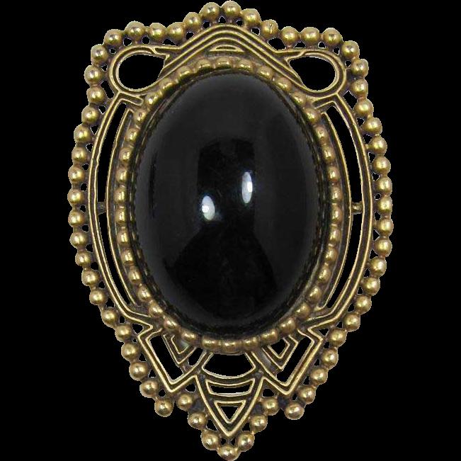 Striking Gold-Tone and Huge Black Cabochon Brooch