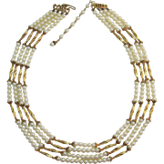 Hobe' Four Strand Imitation Pearl and Gold-tone Necklace