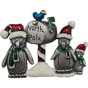 Penguin Family Wearing Santa Hats at the North Pole Pin