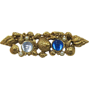 1928 Jewelry Company Seashell and Blue Rhinestone Brooch