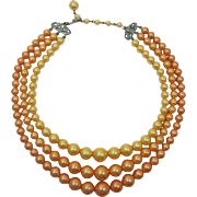 Three Strand Necklace of Light Orange Pearlized Beads