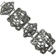Wide Panel Bracelet with Gargoyles and Cherubs