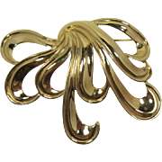 Large and Elegant Monet Polished Gold-tone Bow Brooch