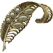1928 Jewelry Co. Elegant Gold-tone and Pearl Feather Brooch
