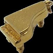 Monet Bright Gold-tone Piano Charm