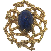 Striking Panetta Brooch with High-Domed Cabochon