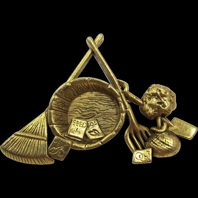 Danecraft Bright Gold-tone Gardener's Pin - Seeds and Rake